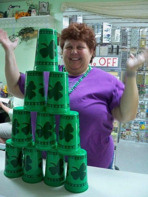 Debbie Playing the Cup Stack Game